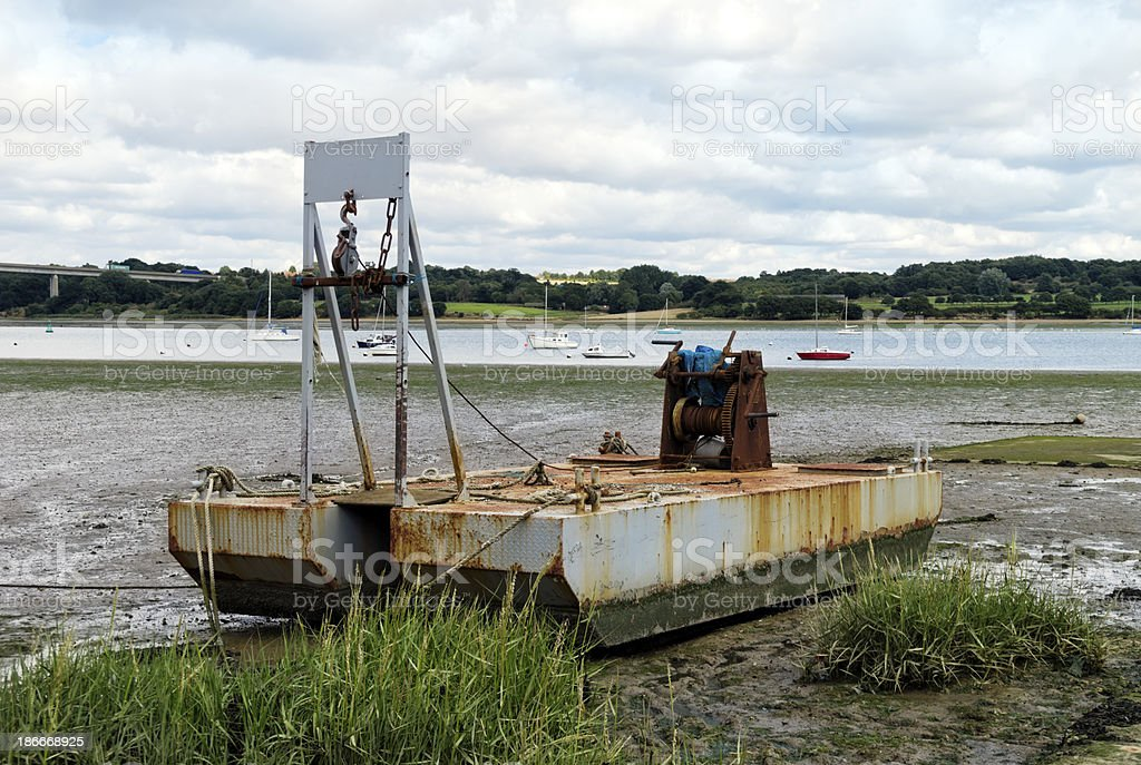 Boat winch in the mud at low tide royalty-free stock photo