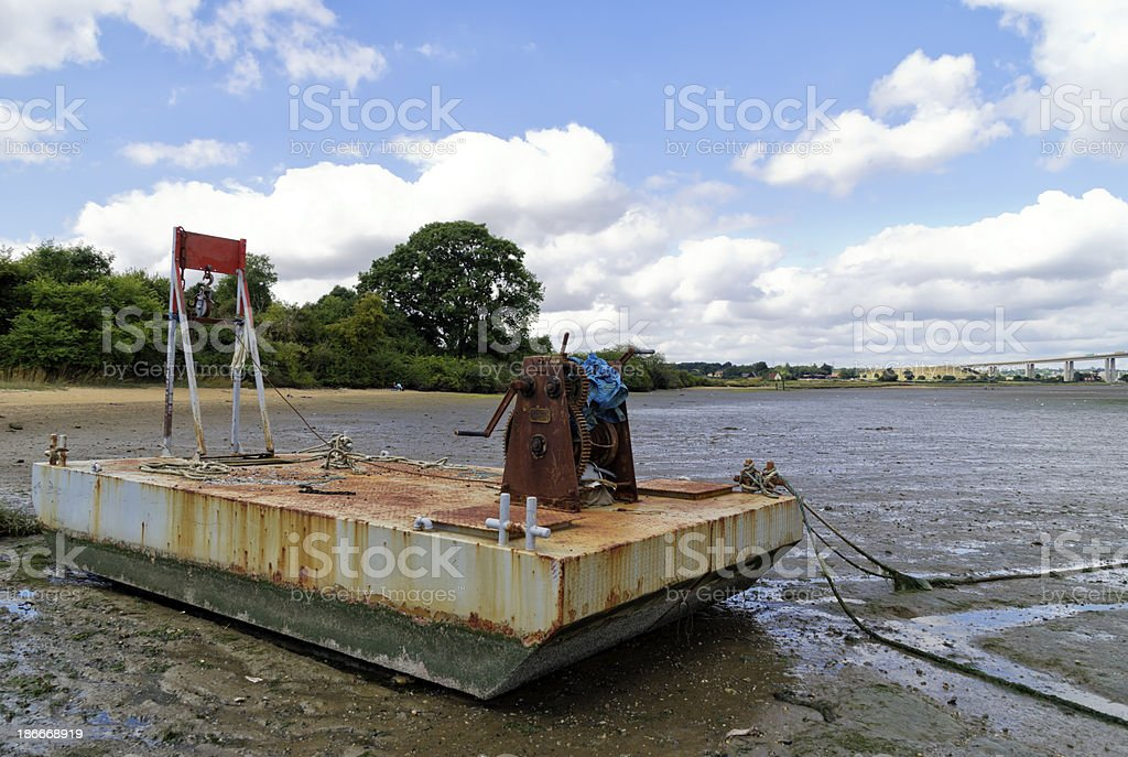 Boat winch in the Orwell mud royalty-free stock photo