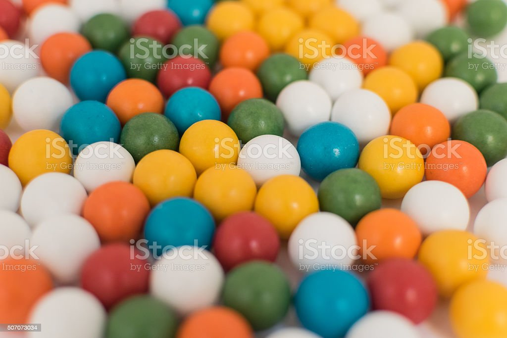 Boat with colorful balls scattered on white background. stock photo