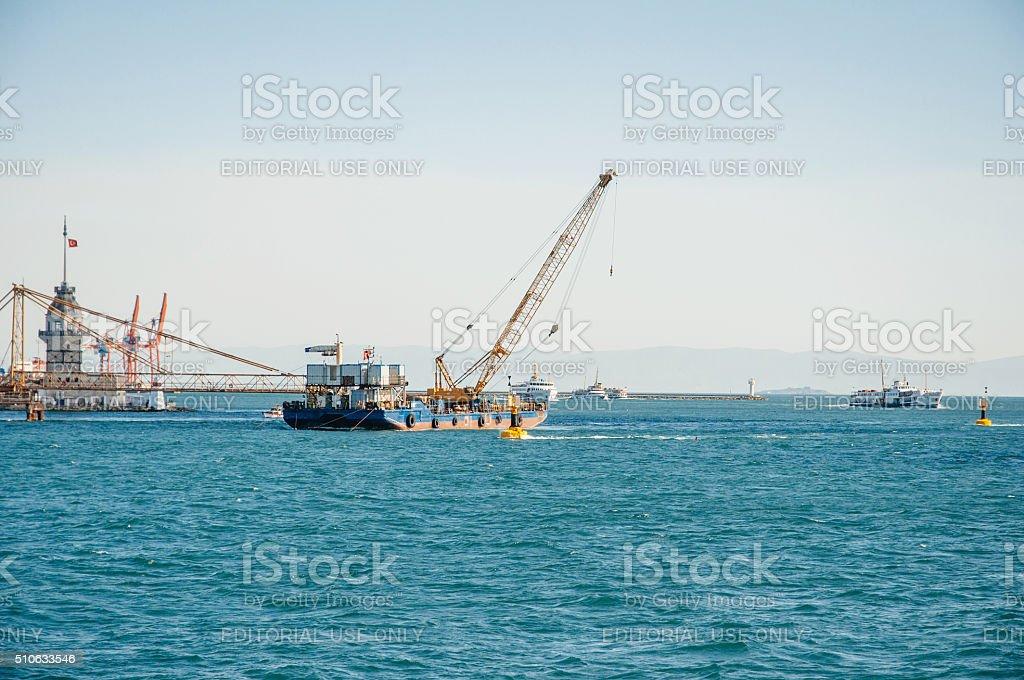 Boat with crane in blue sea stock photo