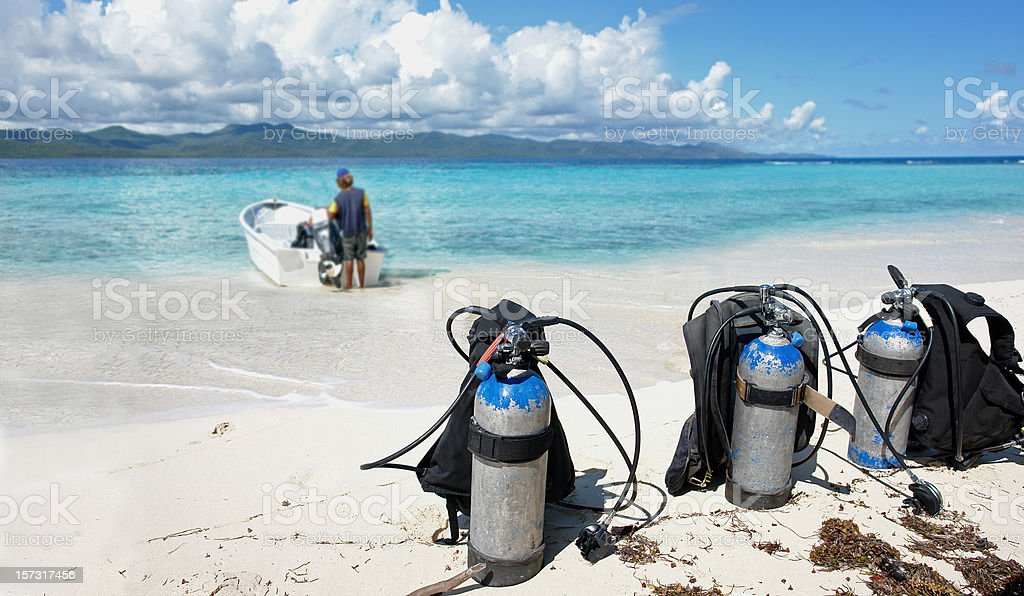 Boat with Diving Equipment on the Beach royalty-free stock photo