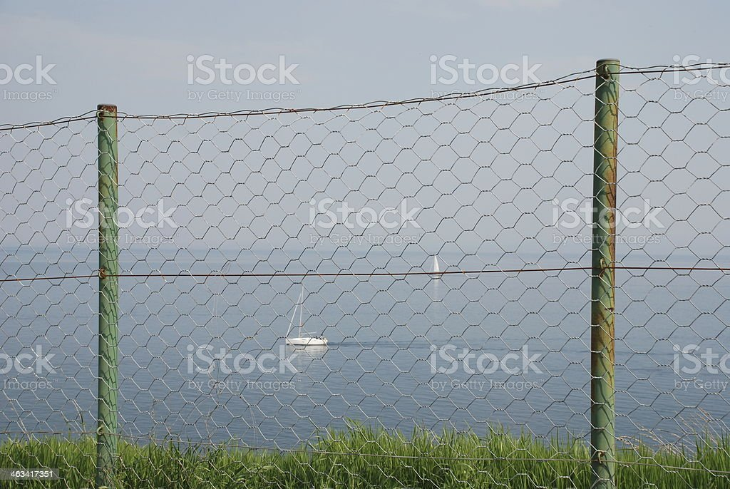 Boat With Fence in Foreground stock photo
