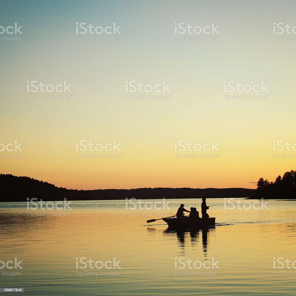 Boat with fishermen. Sunsen on the Kenozero lake. stock photo