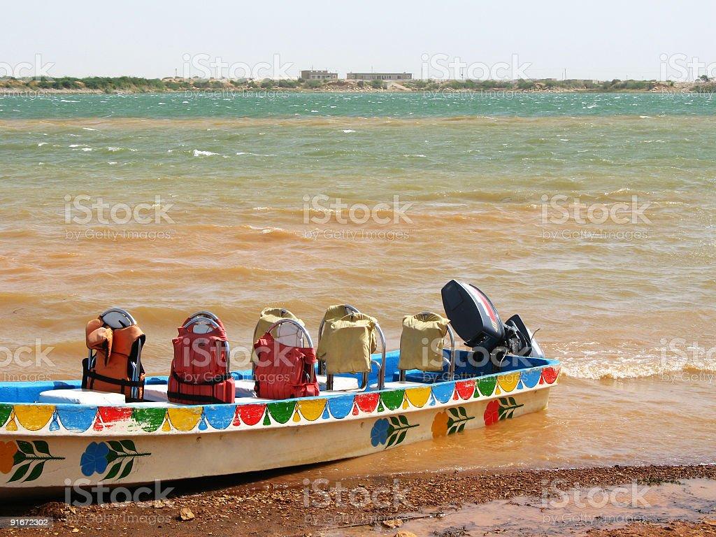 Boat with life jackets royalty-free stock photo