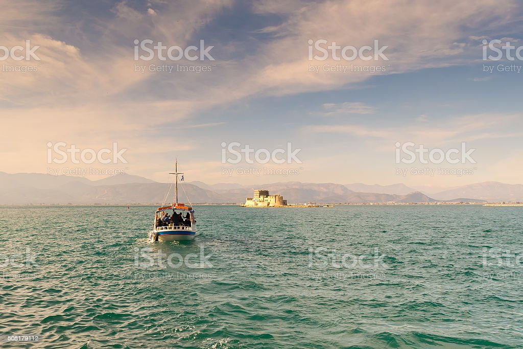 Boat with local people and tourists going to Bourtzi. stock photo