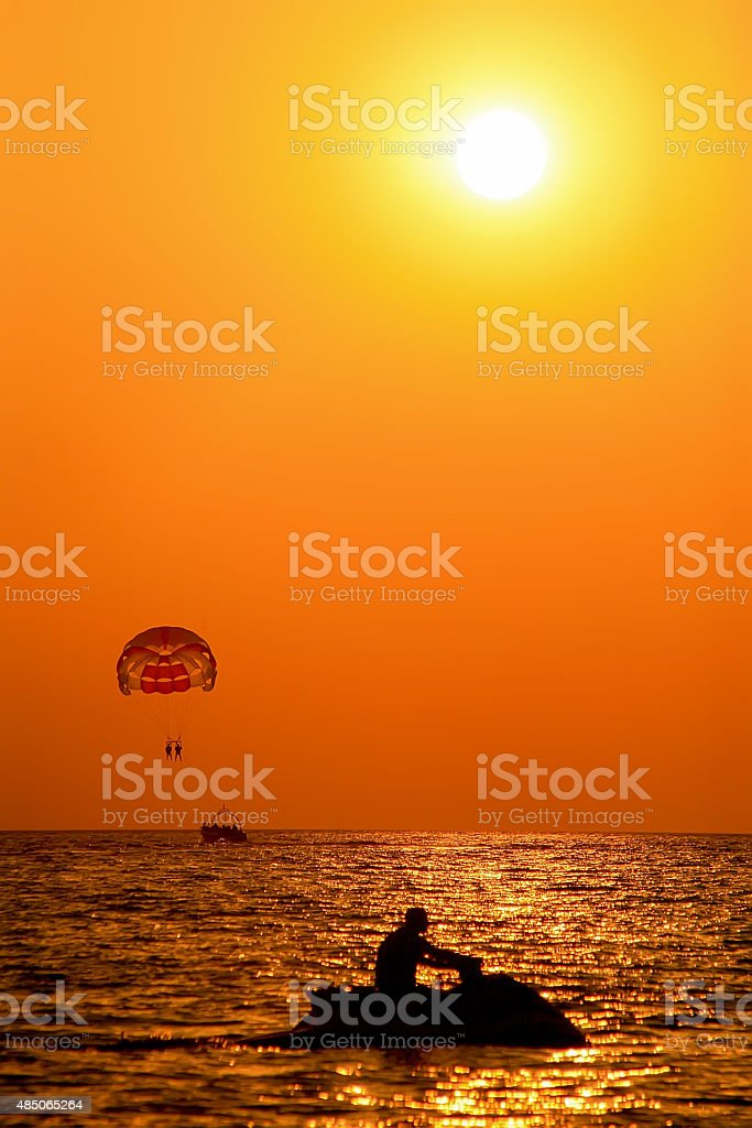 boat with parachute and water bike at sea stock photo