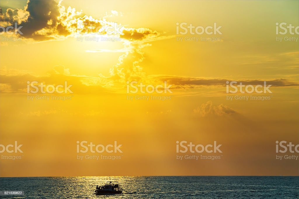 Boat with people in sea stock photo