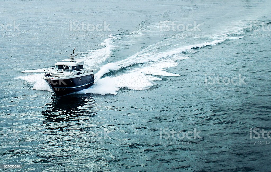 boat with wake in sea stock photo