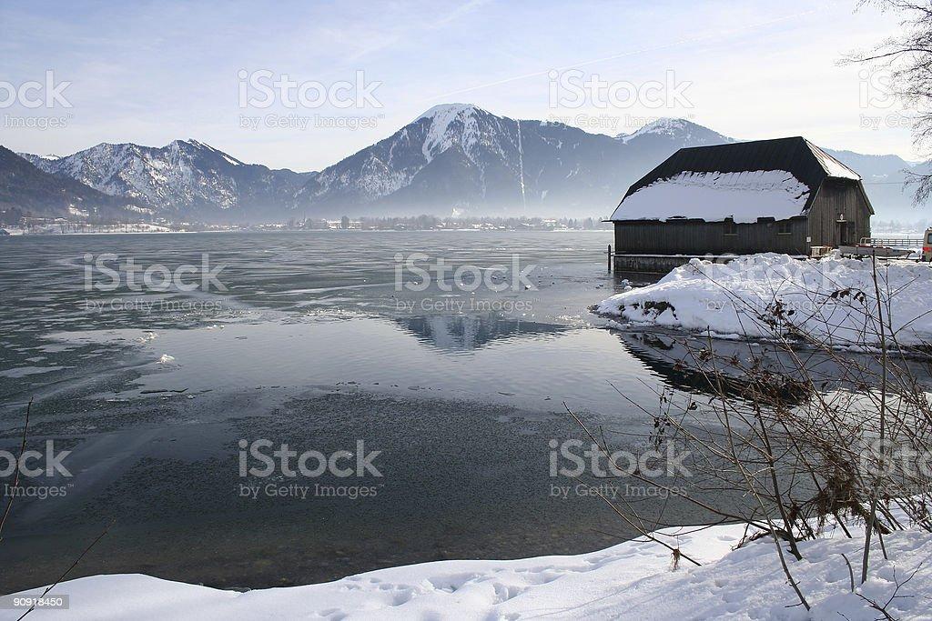 Boathouse and Winter Lake stock photo