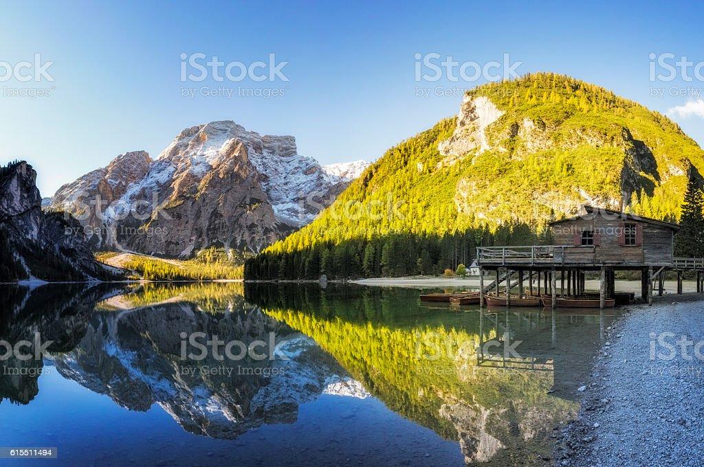 Boathouse at Sunrise at UNESCO World Heritage Lake Braies stock photo