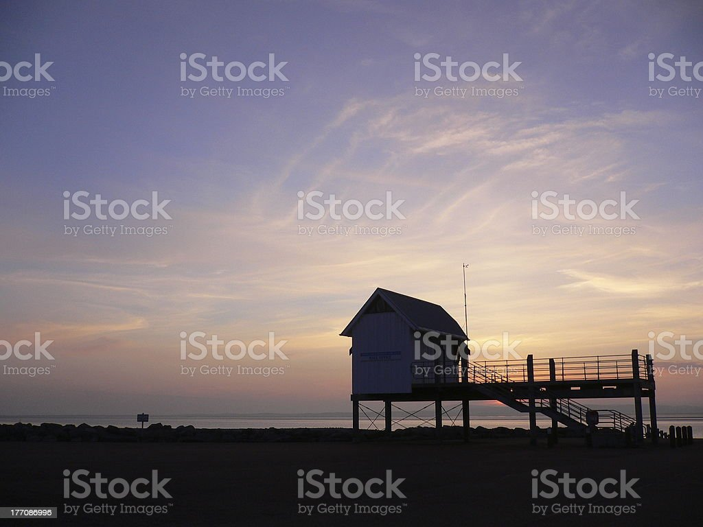 Boathouse at Sunset over Morecambe Bay royalty-free stock photo