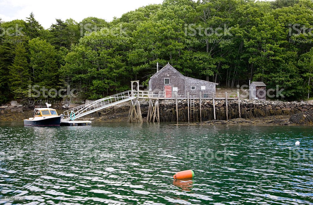 Boathouse in New England coast stock photo