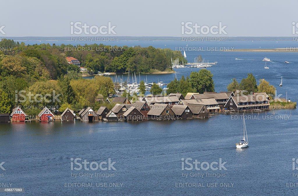 Boathouses and sailing ships on the Mueritz Lake stock photo