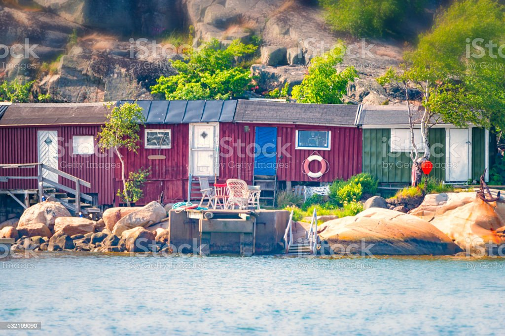 Boathouses in a row stock photo