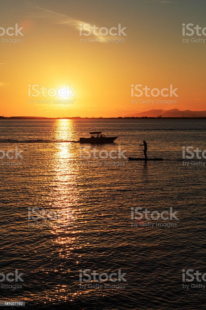 Boating and rafting activities at sunset stock photo