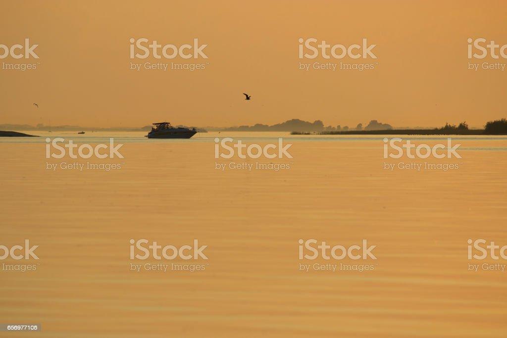 Boating at Sunrise stock photo