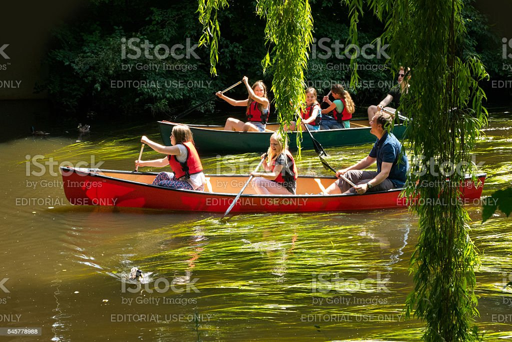 Boating in canoes on the river Bille stock photo