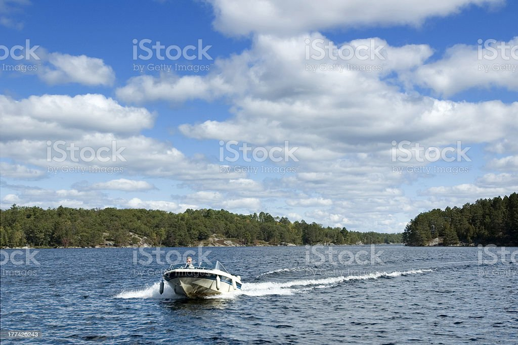Boating on Northern Lake stock photo