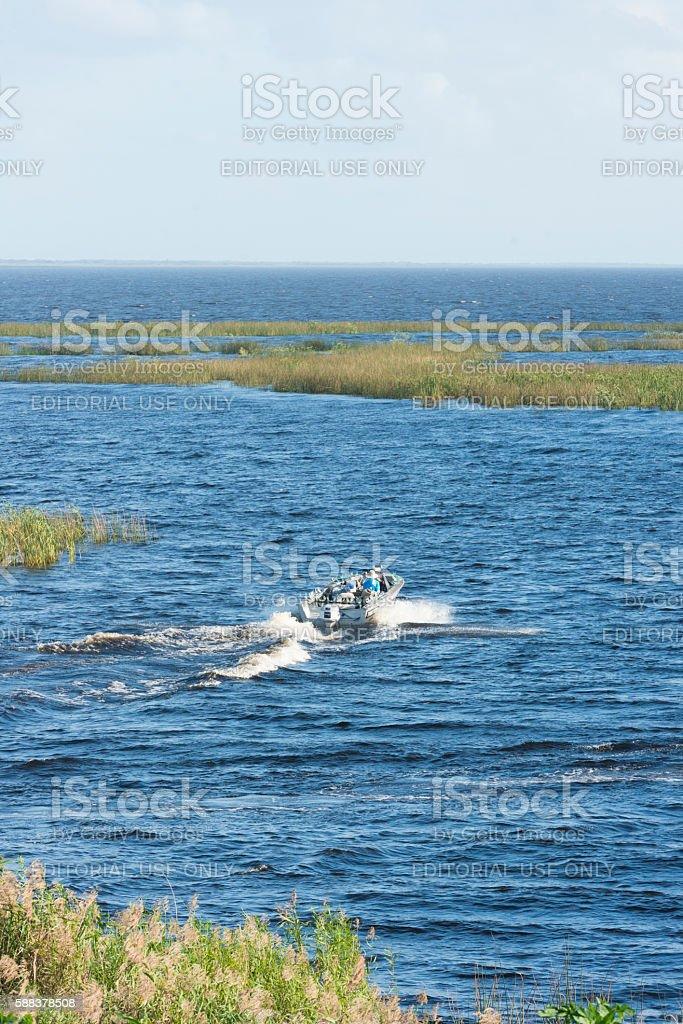 Boating on the water of Lake Okeechobee Canal Florida USA stock photo