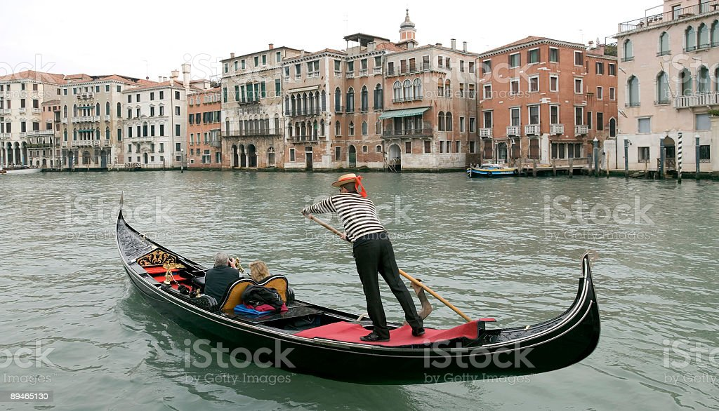 Boatman in a gondola on the Grand Canal in Venice stock photo