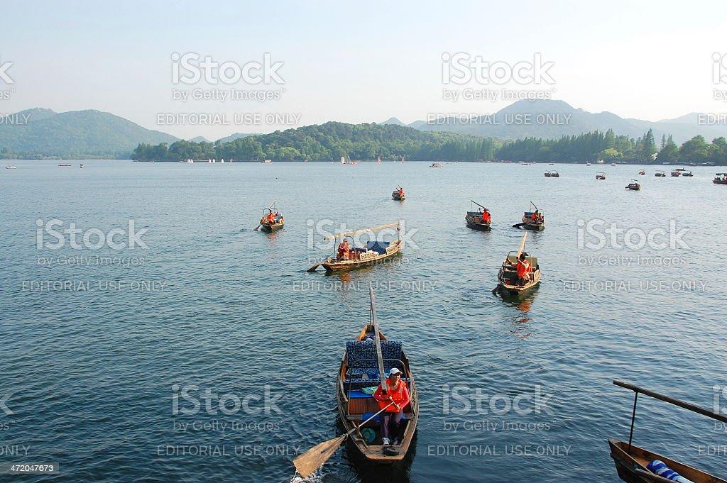boatman in westlake of hangzhou stock photo