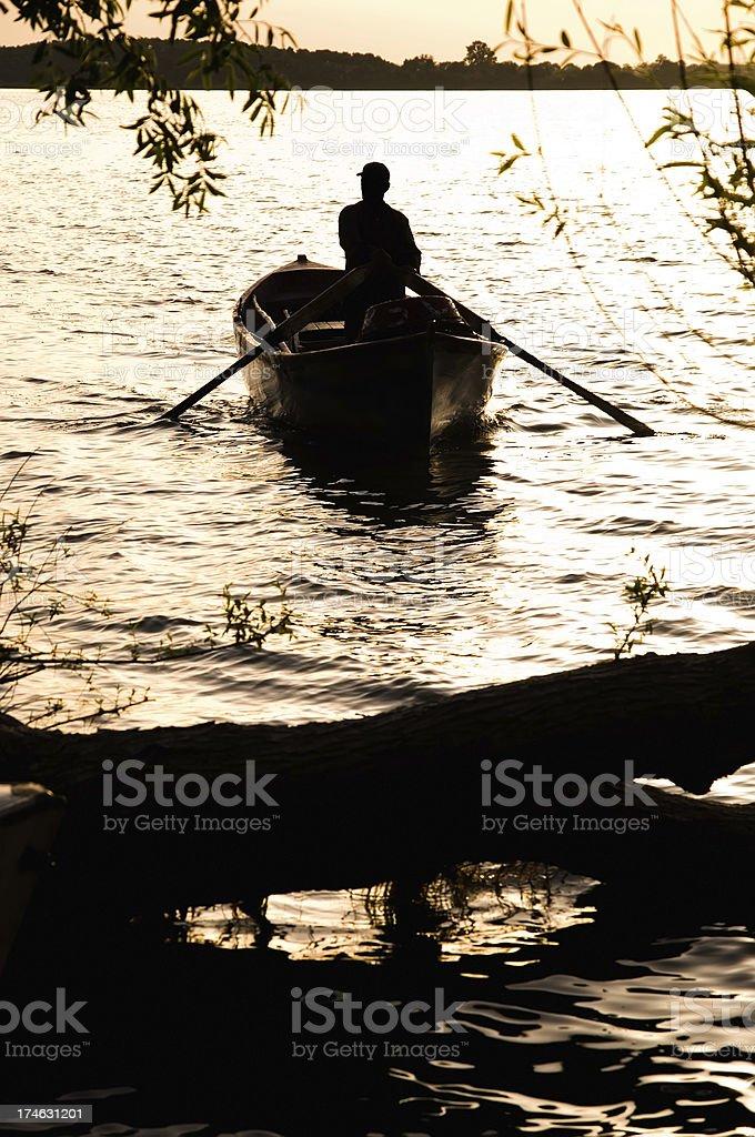 boatman on sunset royalty-free stock photo