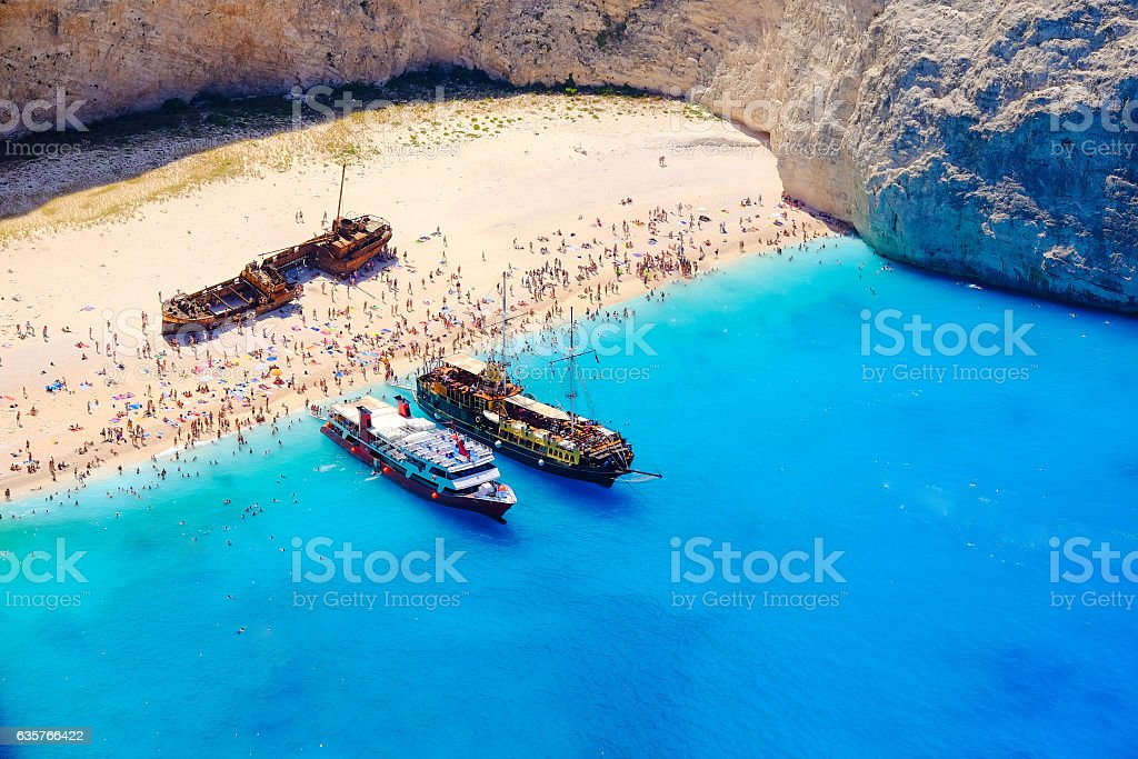Boats anchored at Navagio beach, Zakynthos. Famous shipwreck on stock photo
