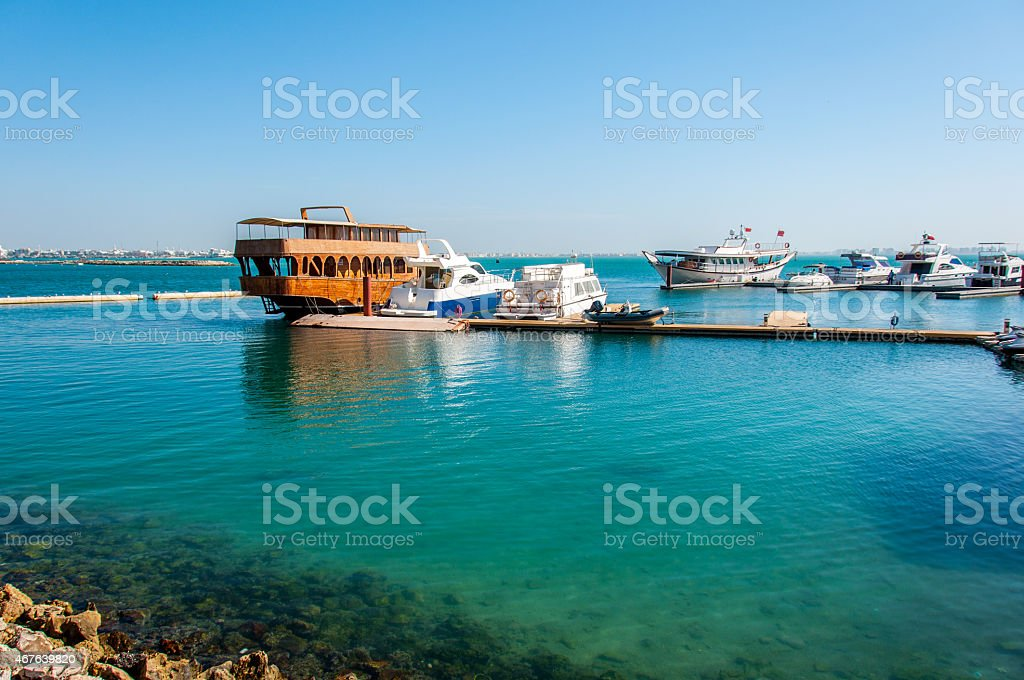 Boats anchored in Bahrain on Persian Gulf stock photo