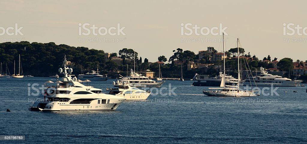 Boats anchored in the bay facing Beaulieu-sur-Mer stock photo