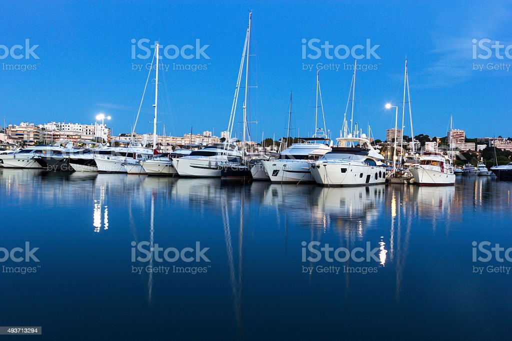Boats anchored in the harbor in Antibes in France stock photo