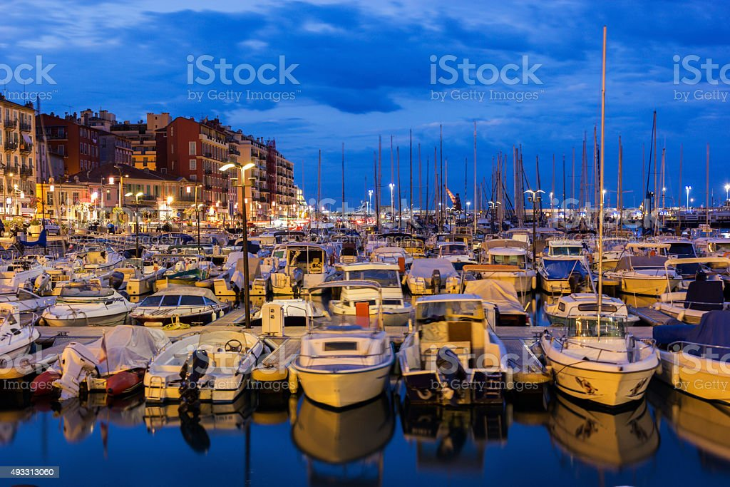 Boats anchored in the Port of Nice in France in the morning stock photo