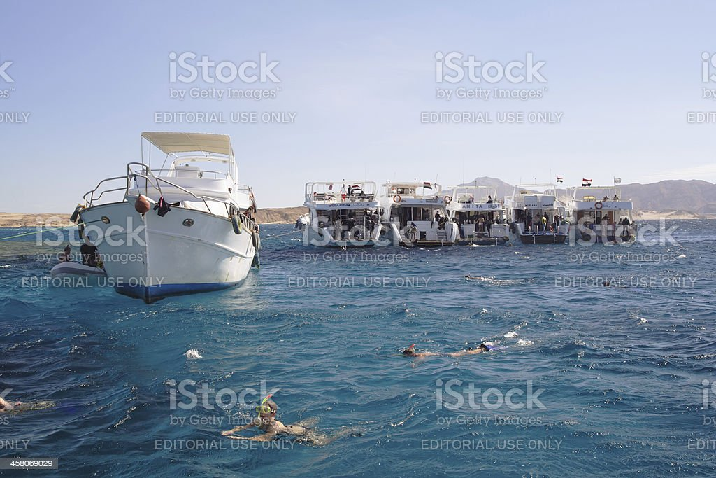 Boats anchored on Red Sea coral reef stock photo