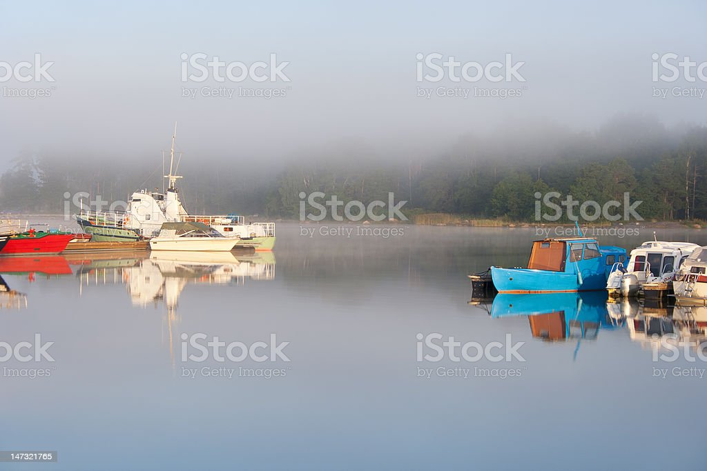Boats and foggy morning royalty-free stock photo