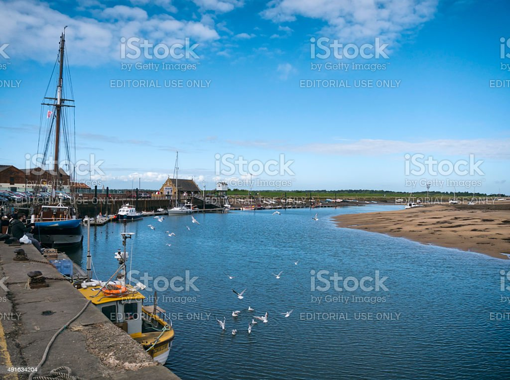 Boats and gulls in the harbour at Wells-next-the-Sea stock photo