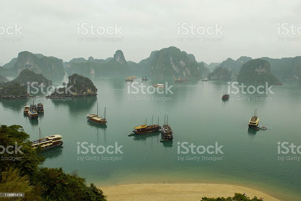 Boats and Islands in Halong Bay, Northern Vietnam stock photo