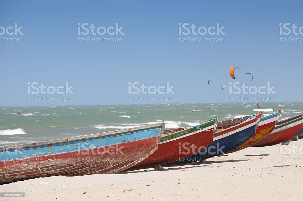 Boats and Kitesurfers in Jericoacoara, Brazil stock photo