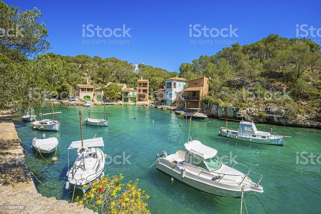 Boats and Majorcian houses in the bay of Cala Figuera stock photo