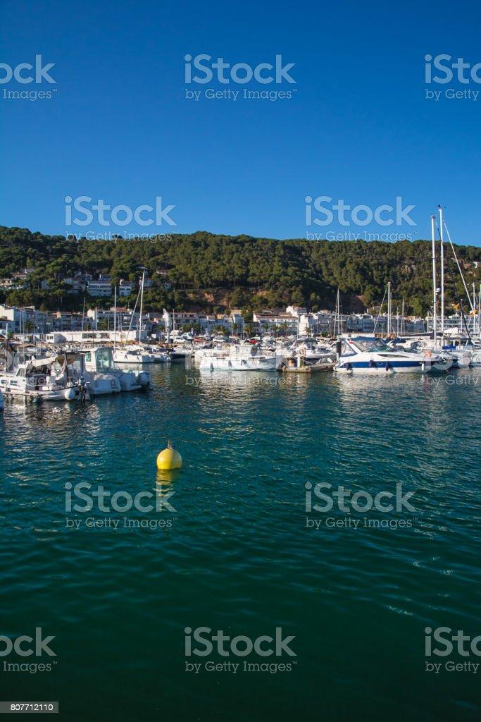 Boats and marina in L'Estartit city stock photo