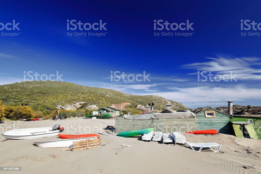 Boats and plastic loungers on the sand. Patara beach-Lycia-Turkey. 1400 stock photo