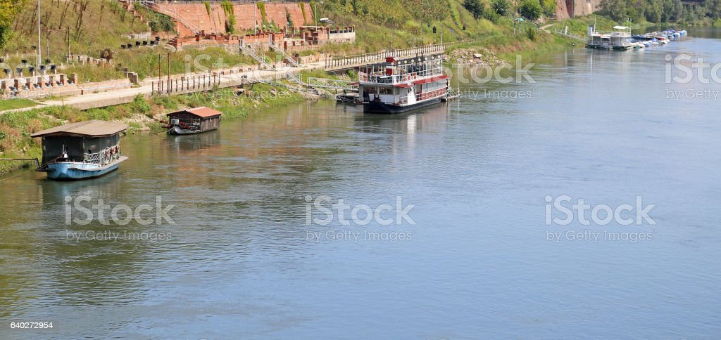 boats and the ticino river from the wooden bridge stock photo
