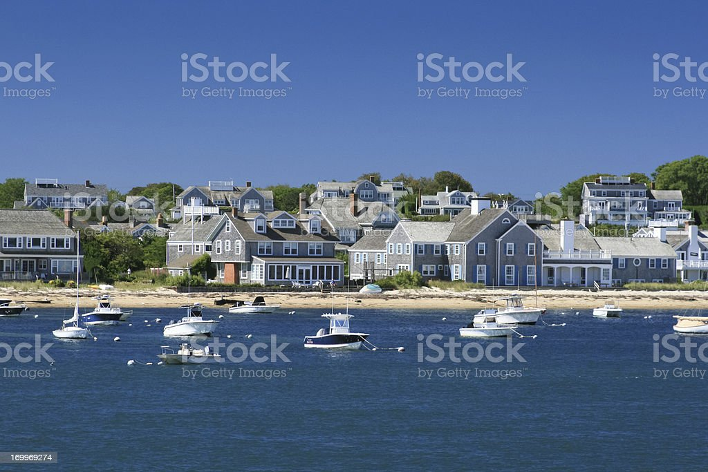 Boats and waterfront Houses, Nantucket, Massachusetts. Clear blue sky. stock photo
