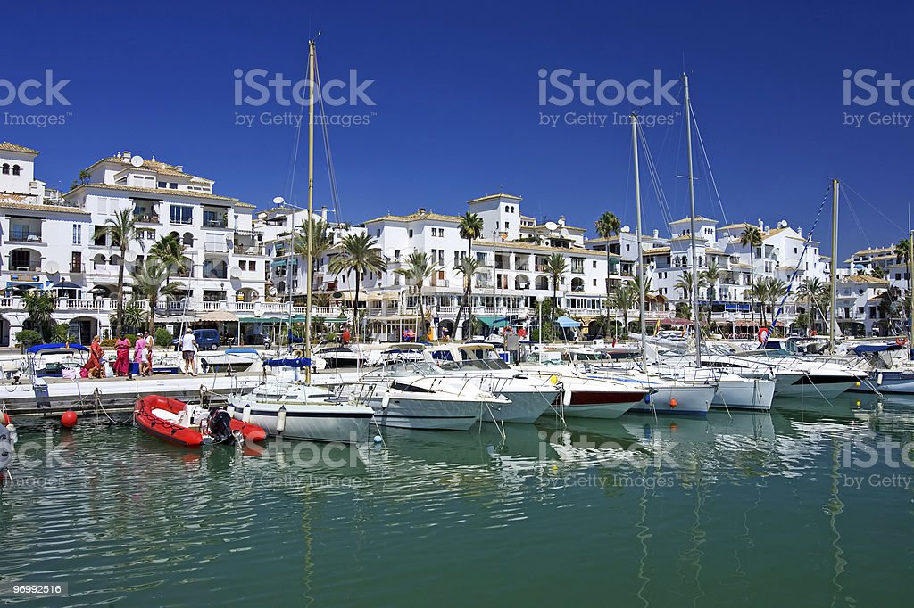 Boats and yachts moored at Duquesa port in Spain royalty-free stock photo