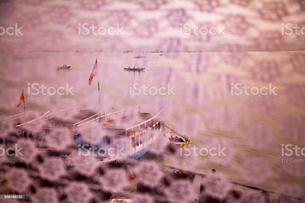 Boats are floating in calm water in evening time stock photo