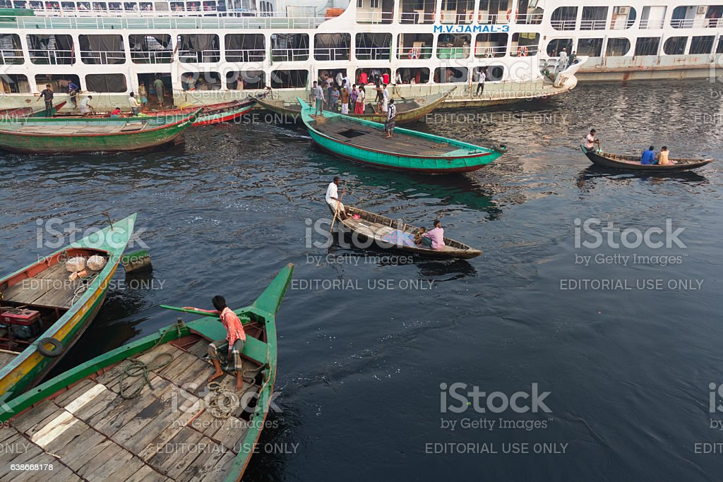 Boats are in queue for carrying passengers from ferry. stock photo