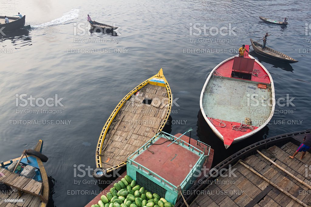 Boats are in queue waiting to load watermelons in Bangladesh. stock photo
