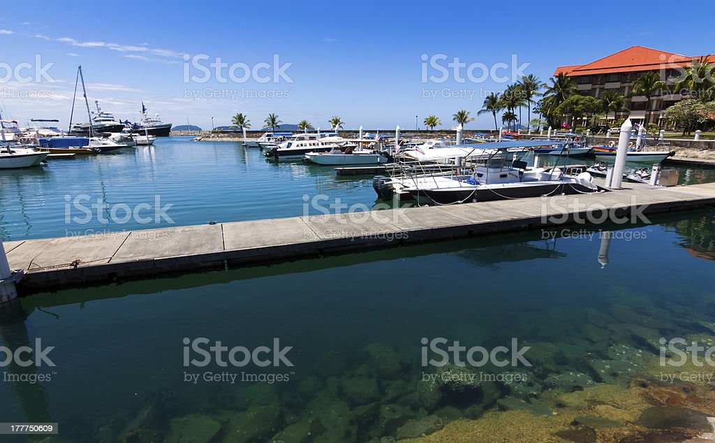 Boats at a harbor with blue sky royalty-free stock photo