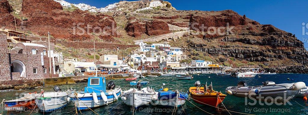 Boats at Amoudi port of Oia town on Santorini island stock photo