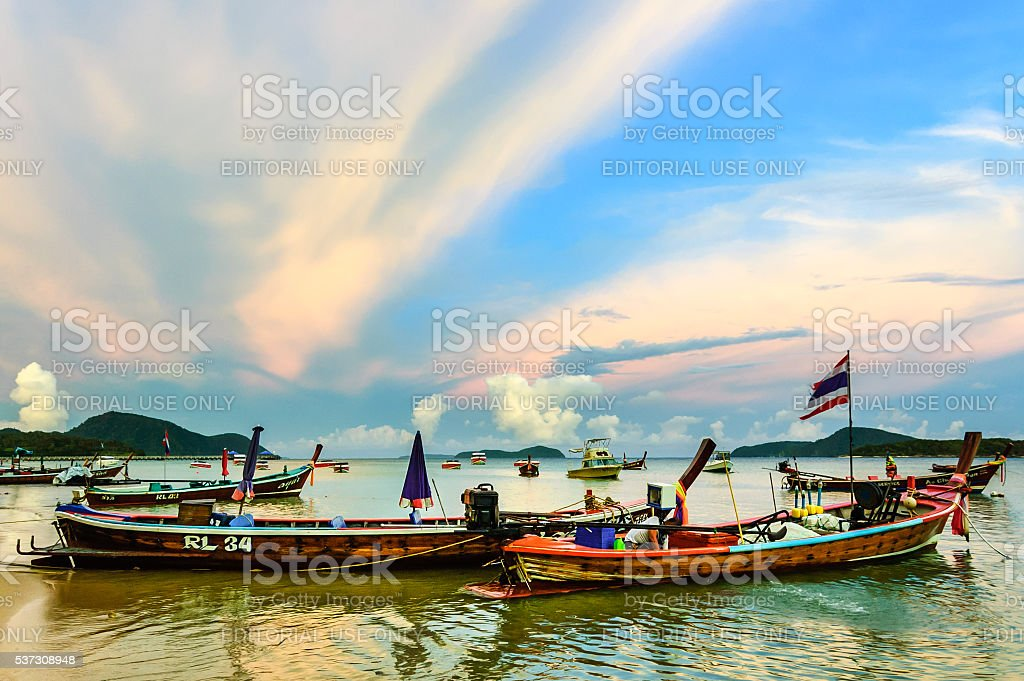 Boats at anchor at sunset, Phuket, Thailand stock photo