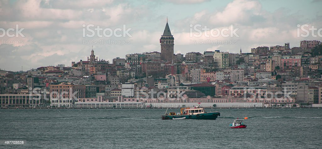 boats at bosphorus in front of galata tower istanbul turkey stock photo