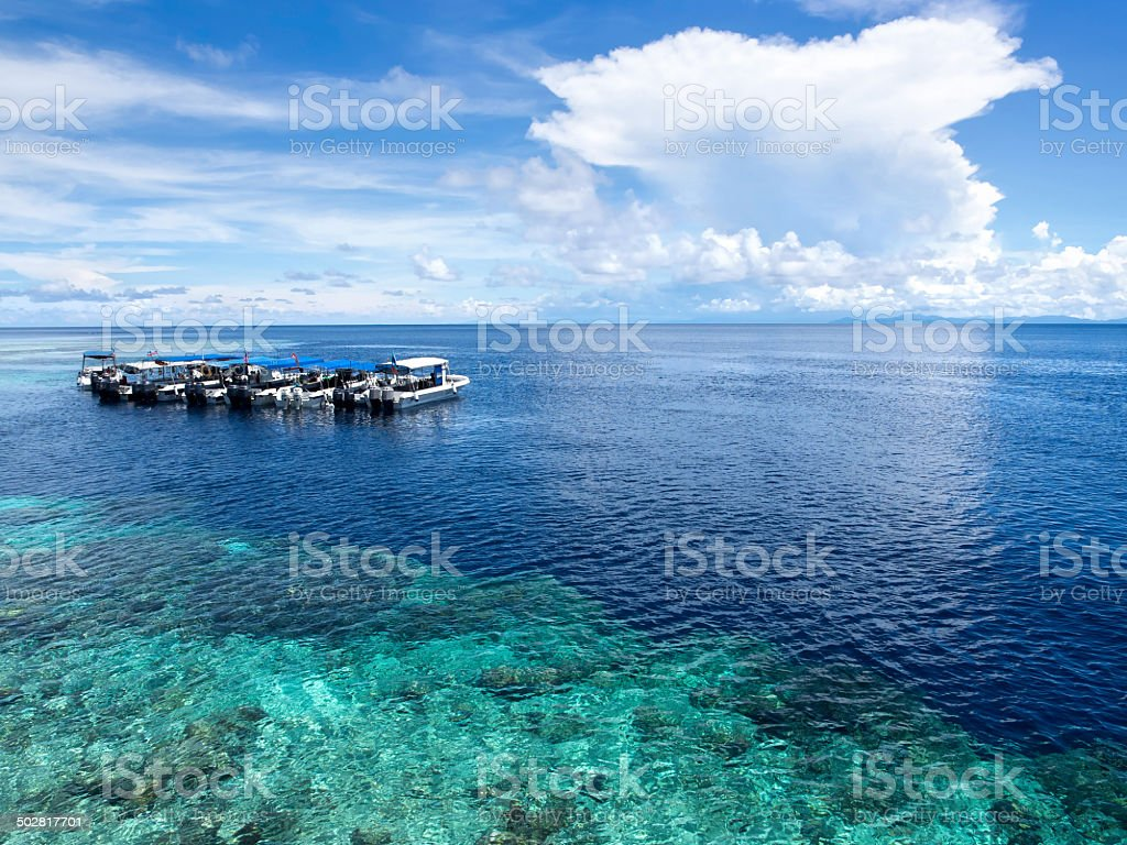 Boats at Dive Site in Sipadan Island, Sabah, Malaysia stock photo
